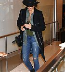 Nikki-Reed-in-Jeans-at-LAX-Airport--10-662x944~0.jpg